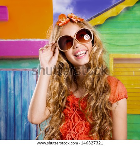 blond children happy tourist girl smiling with sunglasses on a tropical house - stock photo