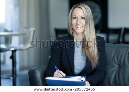 Blond Confident Businesswoman Working At Home - stock photo