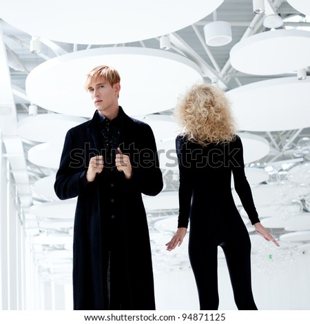 Blond couple classic movie secret agent and sexy girl in black - stock photo