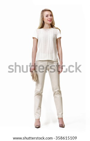 blond fashion business woman with straight long hair in white t-shirt and trousers high heels shoes standing full body portrait isolate on white - stock photo