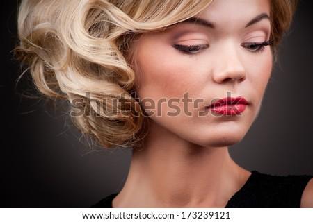 blond fashion girl on a black background - stock photo