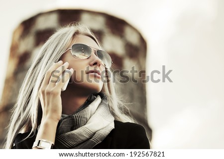 Blond fashion woman calling on the cell phone  - stock photo