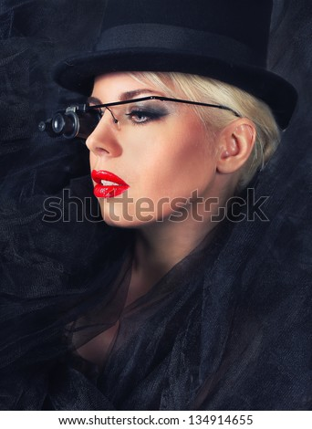 blond fashion woman portrait wearing sunglasses and a black hat