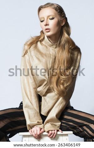 blond fashion woman trousers strips blouse jacket shoes  - stock photo