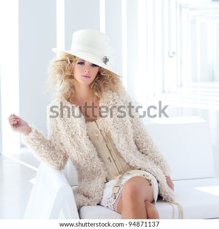 blond fashion woman with eighteenth century corset haute couture - stock photo