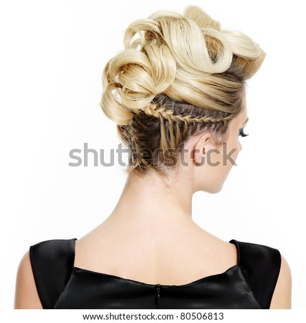 Blond female with creative curly  hairstyle, rear view on white background - stock photo