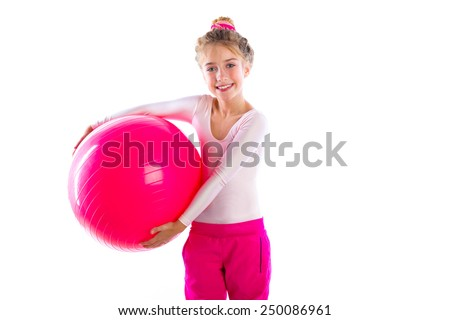 blond fitness kid girls exercise workout with swiss ball fitball on white - stock photo