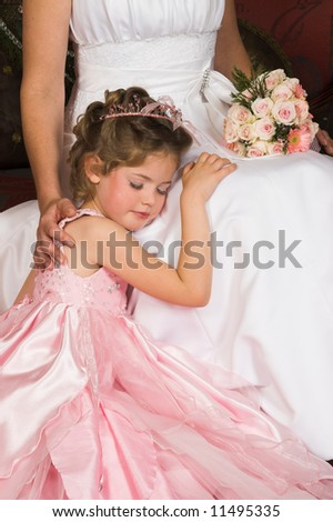 Blond Flower girl wearing a pink dress with bead-work - stock photo