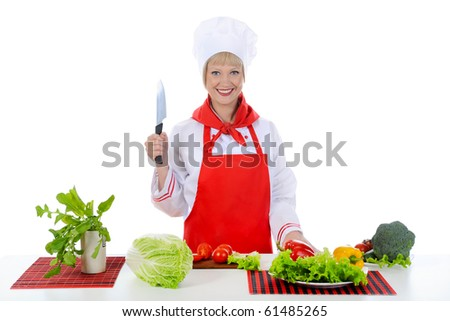 blond girl cuts the tomatoes in the kitchen. Isolated on white background