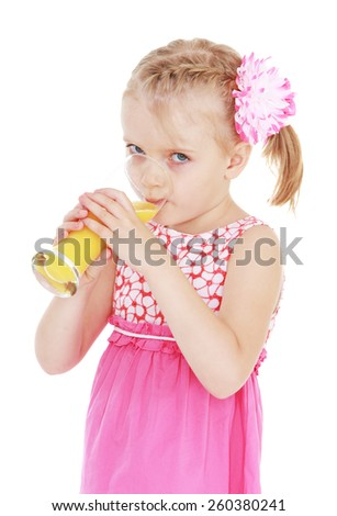 Blond girl drinking juice from a large glass. - isolated on white. - stock photo