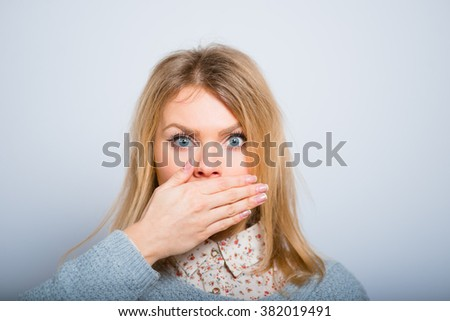 blond girl gesture silence, isolated on a gray background - stock photo