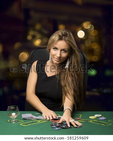 blond girl in a casino playing poker, bokeh - stock photo