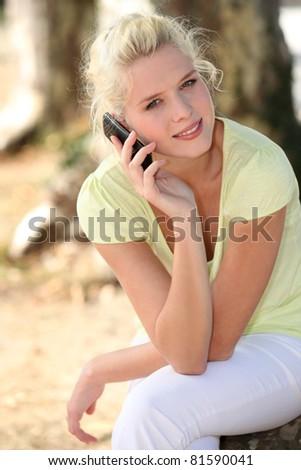 blond girl in a garden - stock photo