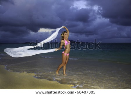 blond girl in pink bikini and chiffon - stock photo