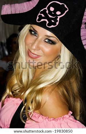 Blond girl in pirate costume on Helloween party - stock photo