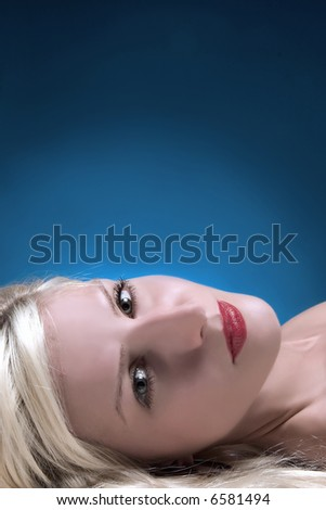 blond girl looking sadly - stock photo