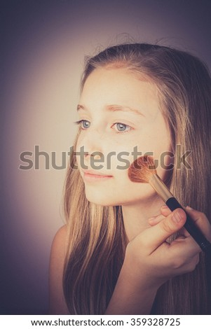 Blond girl, makeup brush trying to conceal, Noise grain effect, vintage, old fashion