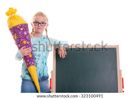 blond girl on first day at school - stock photo