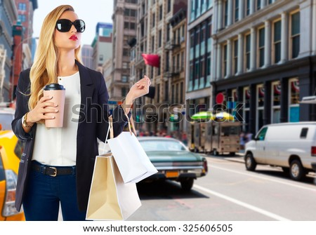 Blond girl shopaholic in Manhattan Soho New York shopping with coffee Photomount - stock photo