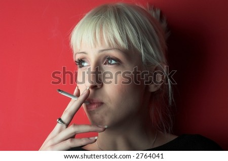 Blond girl smoking.