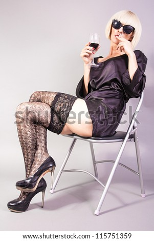 Blond girl smoking a cigarette - stock photo