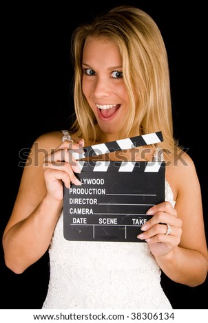 Blond girl with clapper over black background - stock photo