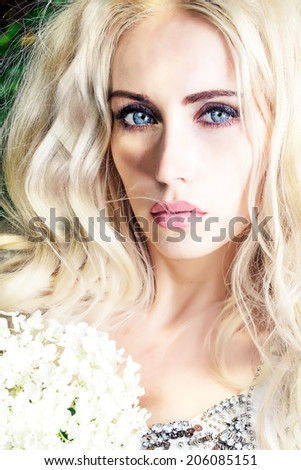 blond girl with flowers in the park