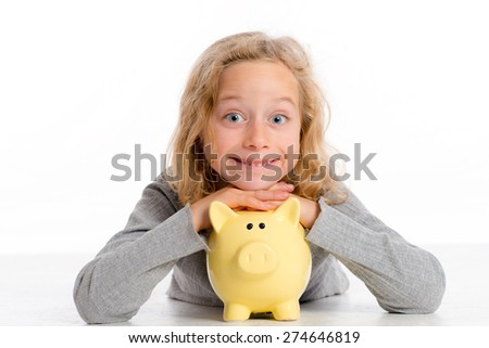 blond girl with piggy bank is happy and smiling - stock photo