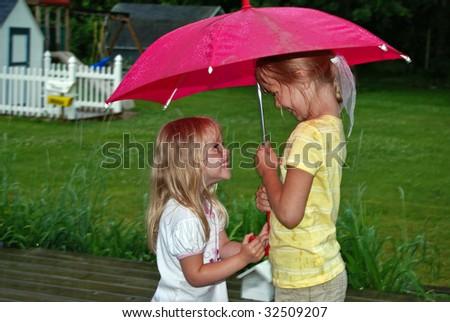 blond girls in the rain - stock photo