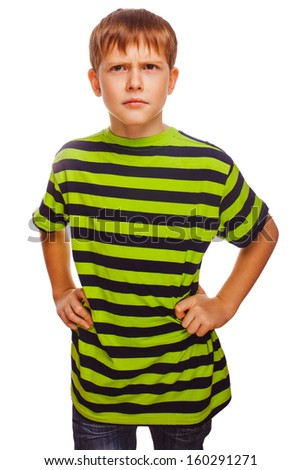 Blond gloomy serious boy in a green striped shirt thinking towards an isolated white background - stock photo