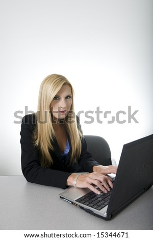blond green eyed business woman in her office