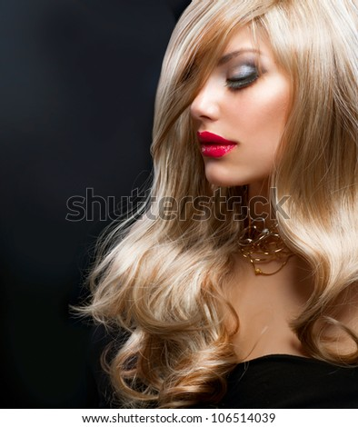 Blond Hair. Beautiful Blond Woman over Black - stock photo