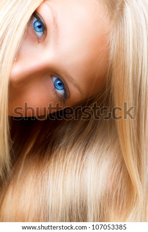 Blond Hair. Blonde Girl with Blue Eyes. Healthy Long Blond Hair. Hair Extension - stock photo