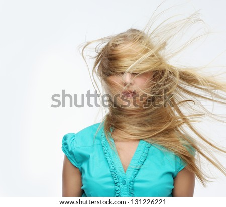 Blond hair  blown over her face - stock photo
