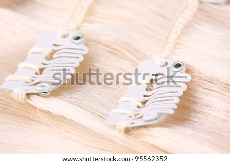 Blond hair extension, clips detail - stock photo