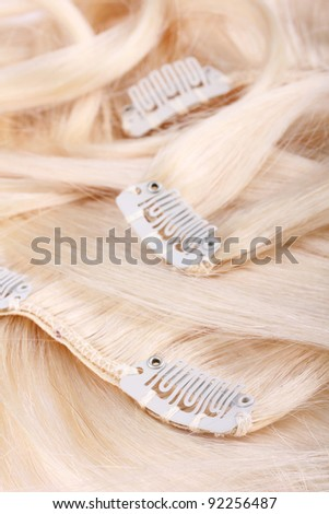 Blond hair extension, clips details - stock photo