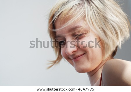 Blond hair girl smiling. People emotions series. - stock photo