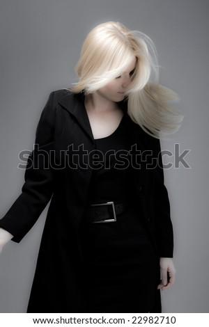 blond hair in motion, studio shot - stock photo