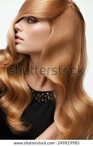 Blond hair. Portrait of beautiful Blonde with Long Wavy Hair. High quality image. - stock photo