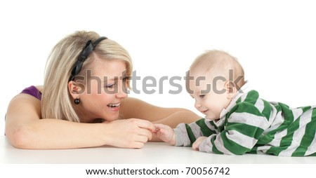 blond hair young woman with her son - stock photo