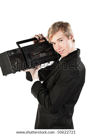 Blond handsome smiling young man holds stereo player in 1980s style - stock photo