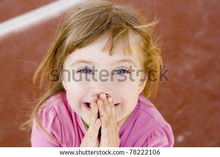 blond happy smiling little girl excited laugh hands in mouth - stock photo