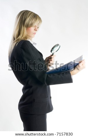 blond hostess in formal suit watching with a lens