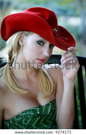blond in cowboy hat