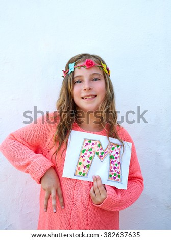Blond kid girl painted M letter also fingers 