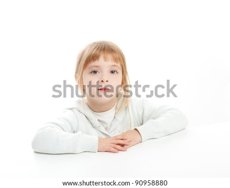 blond kid girl portrait on white desk table isolated studio background