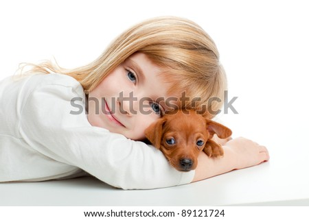 blond kid girl with mini pinscher pet mascot dog on white background - stock photo