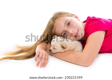 blond kid girl with puppy chihuahua pet dog relaxed playing happy lying on white background - stock photo