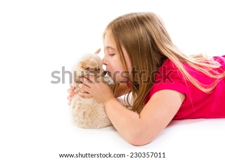 blond kid girl with puppy chihuahua pet dog relaxed playing happy lying on white background