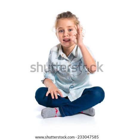 Blond kid making Ok sign - stock photo